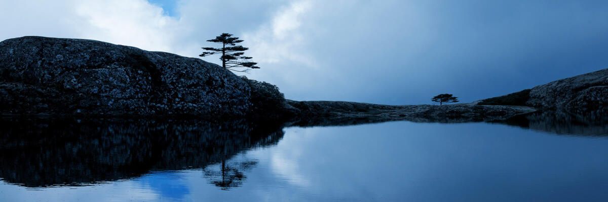 Jiaozi Snow Mountain's Heavenly Pond sits perched at 4,150 meters above sea level