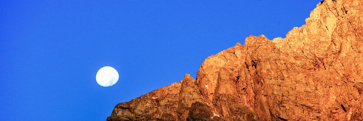 Moonrise over a cliff in Tiger Leaping Gorge, China