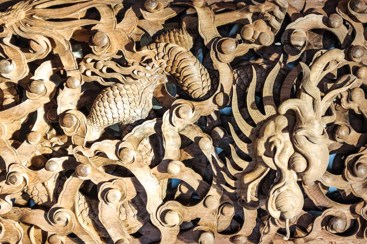 Detail of a hand-carved wooden door at a workshop in Jianchuan, Yunnan
