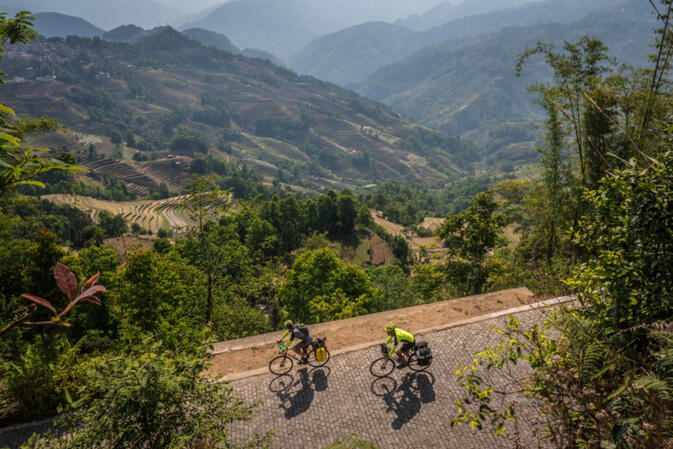 Kyle and Stew cycle through a mosaic of rice terraces and mountains, through the Yuanyang UNESCO World Heritage site (photo credit: Will Stauffer-Norris)