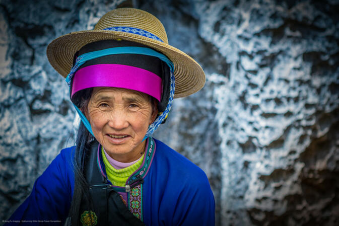 The winning photo in the category 'People' is Beautiful Sani Lady with Natural Stone Background by GoKunming user Kung Fu Imag