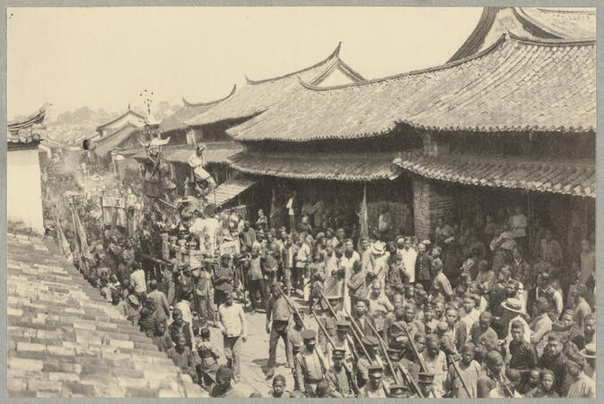 Crowded street procession with soldiers March 6, 1922