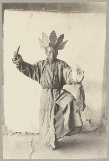 Man in native dress performing religious dance September 1922