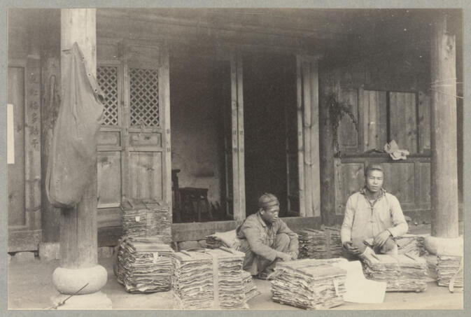Men with plant specimens sitting outside of house September 1922