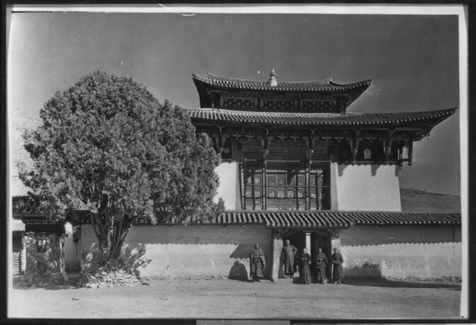 Lamasery building, tree, and lama priests at Yung-ning Undated
