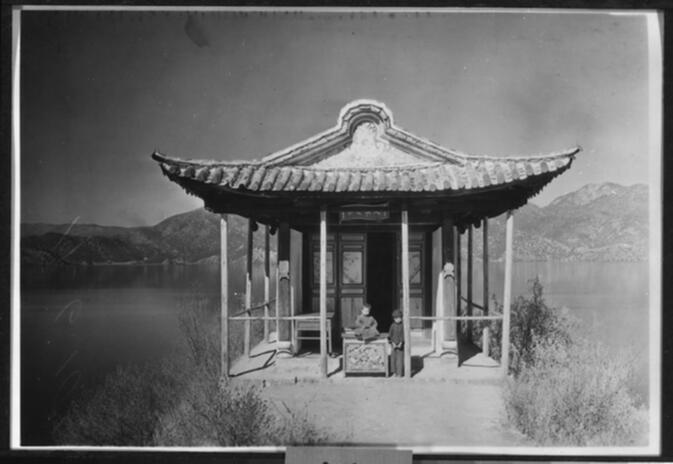 Young tulku and boy at a pavilion on the island of Nyo-ro-p'u in Yung-ning Lake Undated