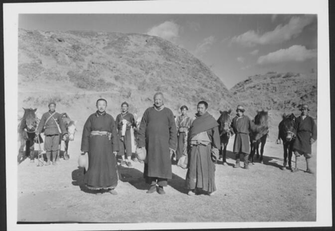 Abbot of Yung-ning, a Shao-fu; the Yung-ning Tsung-kuan, a Yun-shan; and a Tibetan incarnation (front row, left to right) at La-pa-ddü outside Yung-ning Undated