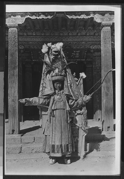 Tibetan oracle or Srung-ma representing an underling of sPang-lung chhos-rje holding a sword and a bow at Yung-ning Lamasery Undated