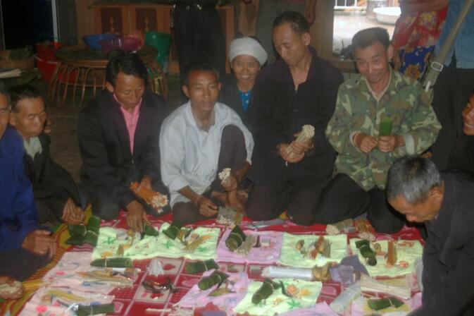 Assembling gift packets for the monks during the Buddhist Lent
