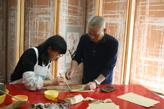 Yang Liqun of the National Ancient Texts Restoration Center teaches a preservation volunteer