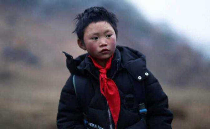 "Wang Fuman, China's ""Ice Flower Boy"", sporting newly donated and much warmer clothes"