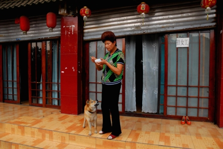 Woman and her dog, Kaili, Guizhou, 2006