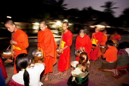 Monks collecting alms in the morning in Luang Prabang, Laos