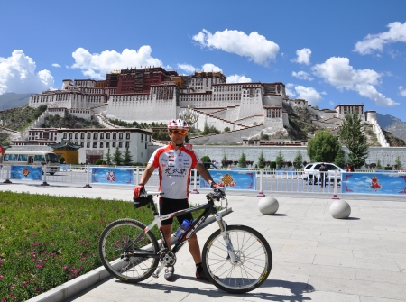 Xiong in front of Potala Palace after cycling from Dali to Lhasa