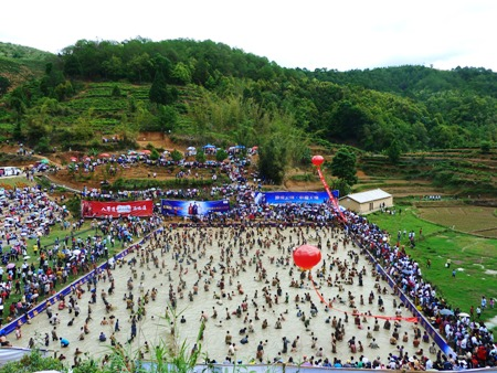 Mud pool in Loulong village, the scene of the inter-departmental tug-o-war and the Hani fish catching competition