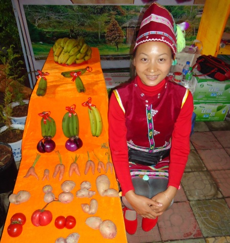 A Hani woman displays her collection of local twin vegetables