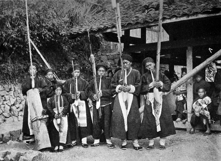 Black Miao men playing the lusheng reed instrument