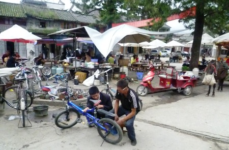 Bike repair, horse carts and snacks at Sifang Jie