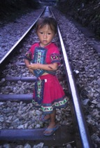 A Miao girl on the train tracks (MH)