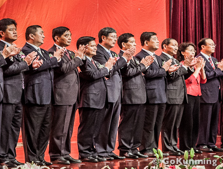 Yunnan governor Li Jiheng (fourth from left) applauding during the June 6 signing ceremony