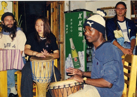 Deng in a drum circle at the Dongfang Lu Camel