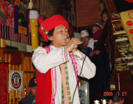 An Yi musician performing with a leaf