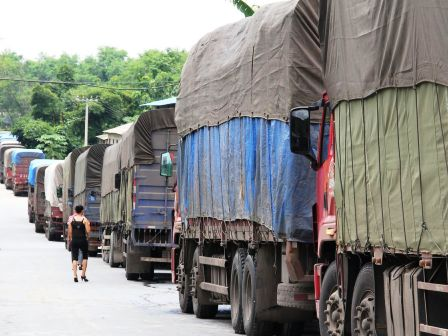 Transport trucks in Hekou lined up to cross from Yunnan into Vietnam