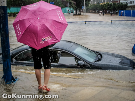 A ruined car, left overnight with its windows down, on Beijing Lu (image: Ben Campbell)