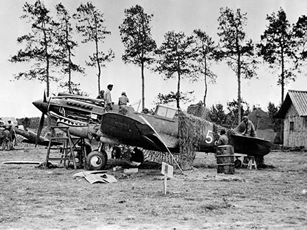 "Maintenance on a Curtiss P-40 of the American Volunteer Group — aka ""The Flying Tigers"" — in Kunming, China, circa 1941."