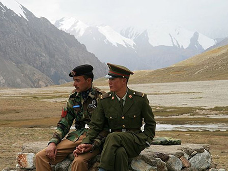 Pakistani and Chinese border guards at Khunjerab Pass