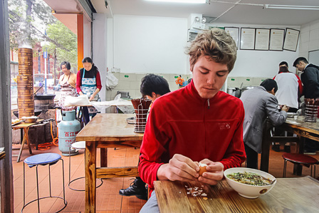 A breakfast of boiled eggs and mixian for Chris in Kunming