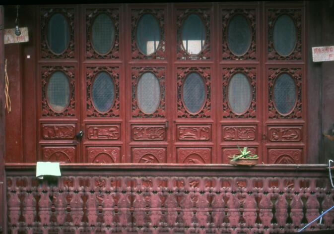 Carved doors and railing on old Wucheng Lu