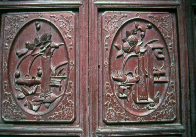 Ornately carved shutters on old Wuyi Lu