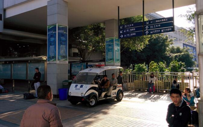Unmanned police vehicle manned by local kids — right in front of the train station ticket office