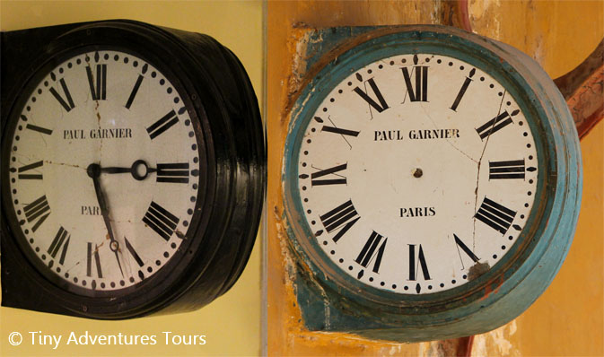 Paul Garnier electrical clocks made in Paris. On the left is a clock displayed in the museum. On the right is the single remaining one at Beshizhai Station, minus its hands