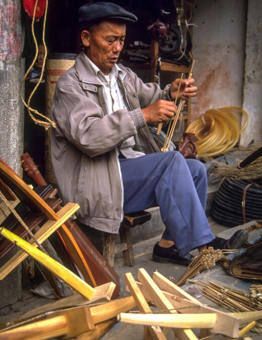 Crossbow seller in Liuku making bolts