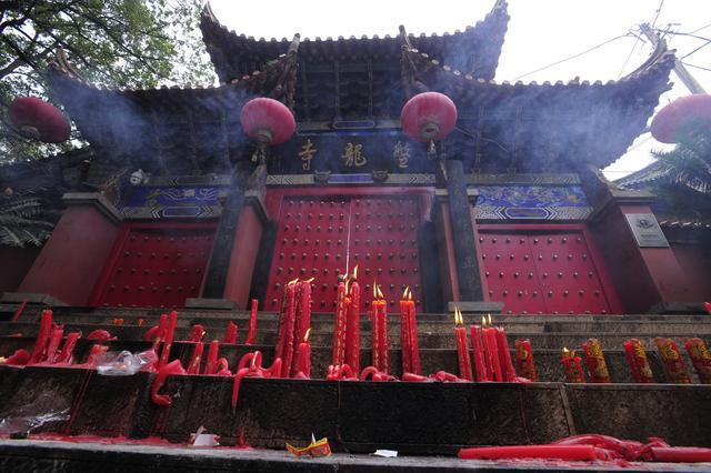 Candles placed outside Panlong Temple by visitors who were not allowed inside