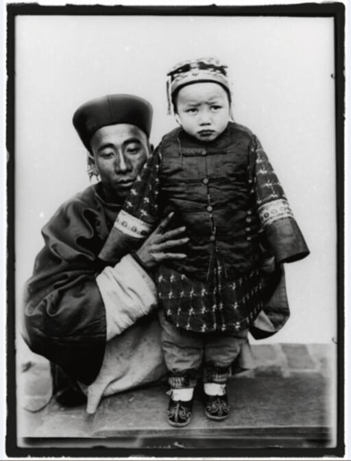 Portrait of a father wearing an official Qing Dynasty robe and holding his daughter