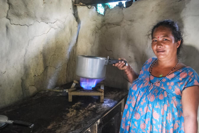Homescale Biogas Nepal: a Nepali woman cooking with gas produced from cow dung