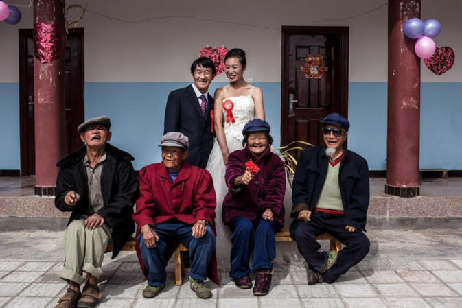 Groom Li Kaiyuan (back left) and bride Lu Chunxiu (back right) celebrate their wedding with four former residents of Luduo leper colony