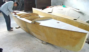 Finishing work on a trimaran hull