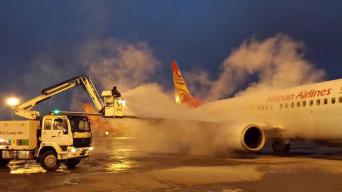 File photo of a plane being de-iced