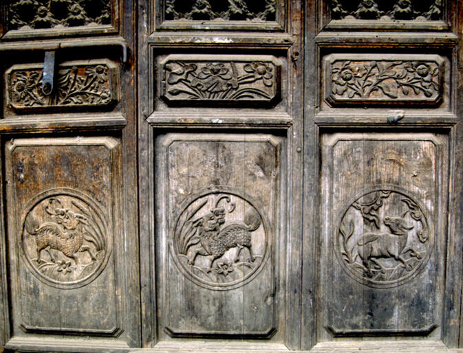 Detail of hand-carved doors