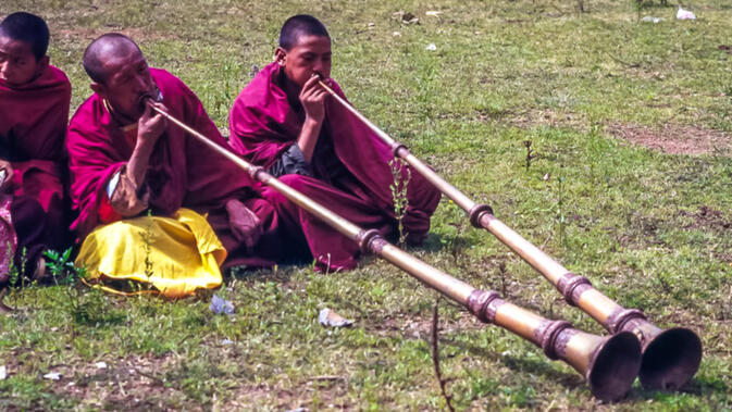 Monks playing horns during Rounding the Mountain Festival