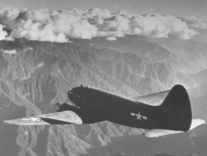 A Curtiss C-46 Commando flying 'The Hump' over the Himalayas during World War II