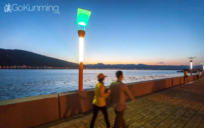 Locals stroll along the Dianchi Lake promenade near Haigeng Park