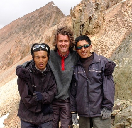 Jeff Fuchs (middle) with Tibetan travel partners at Trola Pass in Tibet, more than 5,000 meters above sea level