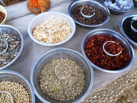 Healthy snacks including dried fruit and hemp seeds are sold by the roadside
