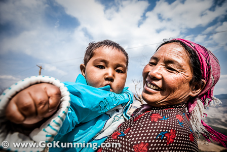 A Mosuo woman and child outside of Lijiang