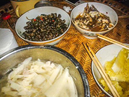 A meal of snails, fish, pineapple, and sweet bamboo shoots